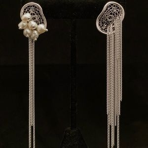 Silver and pearl chain earrings.